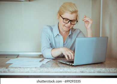 A woman in normal clothes working at home. Startup of the project