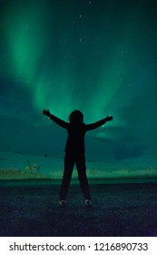 Woman and the Northern lights.