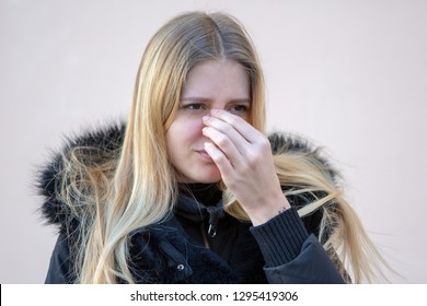 Woman with nose pain outside in winter