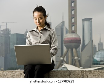 Woman with a notebook computer.