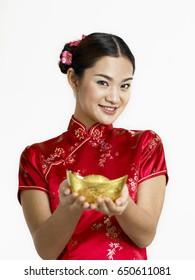 woman offering gold ingot with text on ingot prosperity