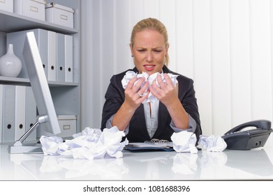 woman in the office with crumpled paper