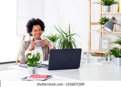 Woman at the office with cup of coffe with laptop in front of her