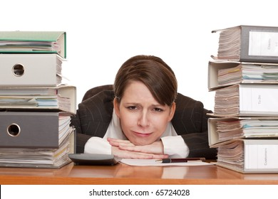 Woman in office with folder stacks is desperate, stressed and over-worked.