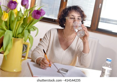 woman at office refreshed with a glass of water