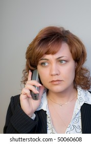 The woman at office speaks by phone