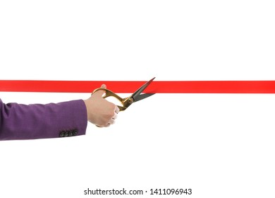 Woman in office suit cutting red ribbon isolated on white, closeup