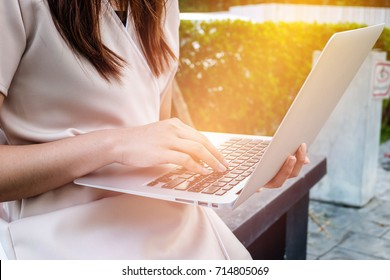 Woman office worker is typing keyboard, using laptop anywhere concept