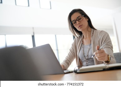 Woman in office working on laptop computer