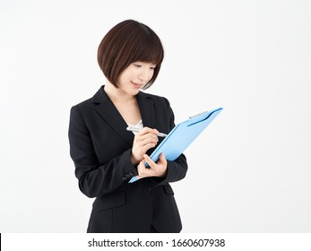 Woman OL taking notes on binder with white background