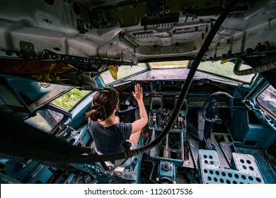 A woman in an old broken airplane,Airplane Graveyard, Bangkok, Thailand