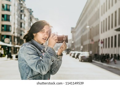 Woman with old camera in the city