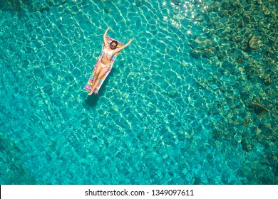 Woman on air mattress in the sea. Young woman on air mattress in the sea