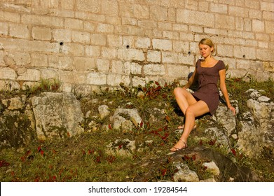 Woman on the ancient stones