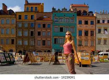 Woman on the ancient street in warsaw