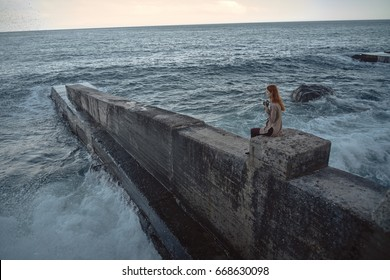 Woman on the background of the sea, fresh air