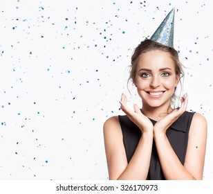 Woman on the background of shiny confetti from the free space on the left
