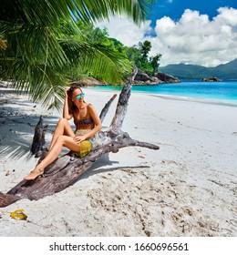 Woman on beach Anse Soleil at Seychelles, Mahe