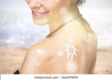 Woman on beach background suntan lotion sunbathing human skin moisturizer suncare protection