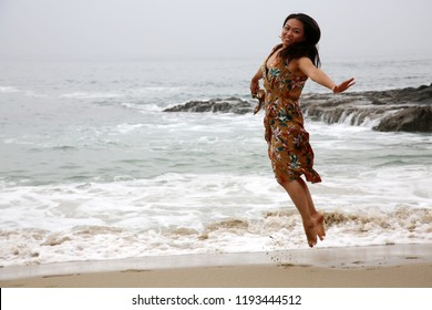 Woman on the beach. A beautiful woman enjoys a day at the beach. Southern California Beach. Vacation.