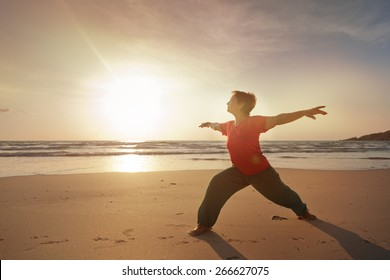 woman on the beach doing fitness, on sunrise