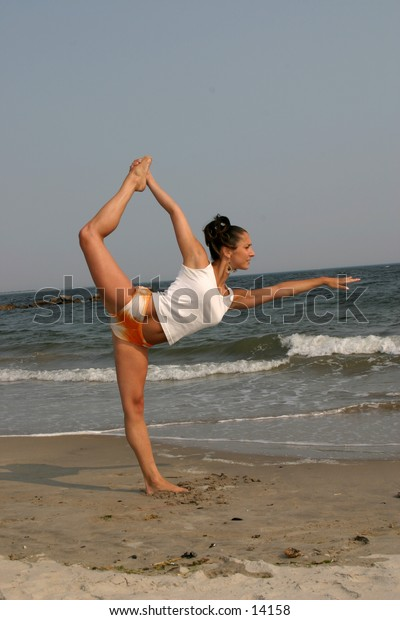 woman on beach doing yoga