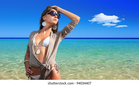 Woman on the beach enjoying the summer