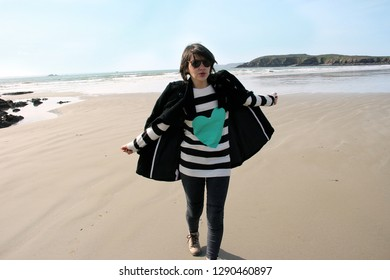 woman on a beach in french Brittany in a beautiful winter day