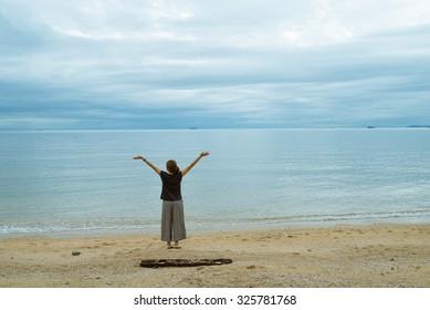 woman on the beach near the ocean in Thailand