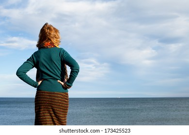 Woman on the beach waiting for somebody