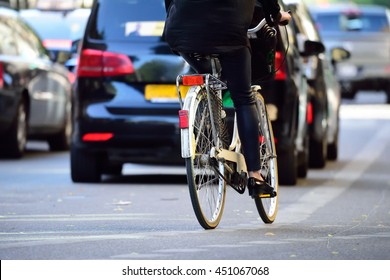 Woman on bike in traffic