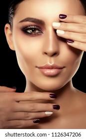Woman on a black background. Beautiful bright fashion model. Beauty girl. Luxurious lady with a stylish make-up and manicure.