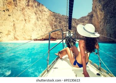 Woman on board of sailing yacht in Zakynthos island  Greece
