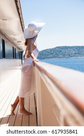 Woman on a boat deck with a hat