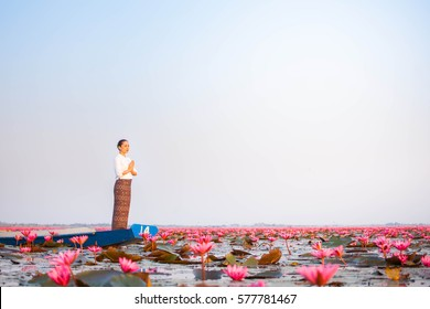 Woman on a boat in the lake Lotus red.