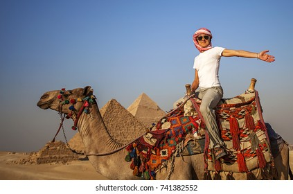Woman on a camel close to the Pyramids of Giza