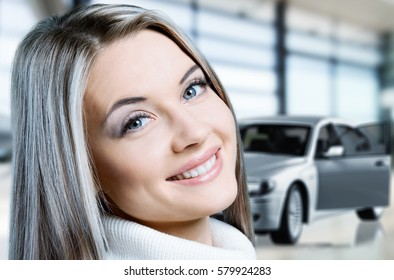 Woman on car background.