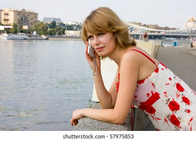 Woman on cellphone.  Young attractive brunette woman using mobile phone Happy girl Laughing