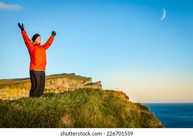 Woman on a cliff in Wesfjords, Iceland