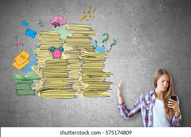 Woman on concrete background using smartphone and saying no to abstract drawing of paperwork stacks, alarm clock and other items. Job duties concept