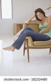 Woman on confortable sofa at home