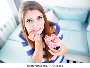 Woman on diet caught during eating unhealthy donut
