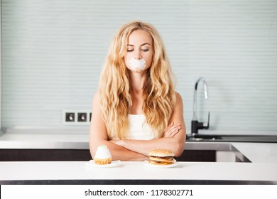 Woman on a diet. Girl with mouth sealed looking for food