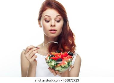 Woman on a diet . Strict diet. salad