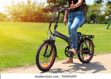 woman on electric bicycle in the park