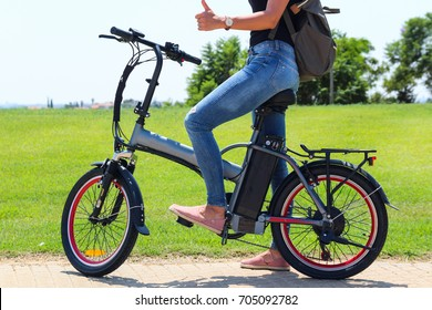 woman on electrice bike in the park