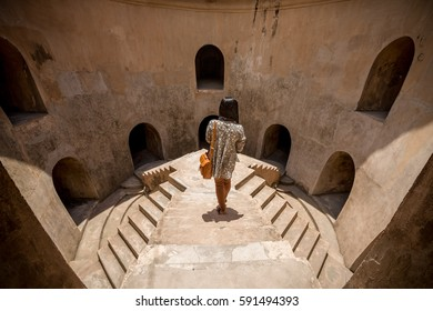 Woman on elevated walkway in Taman Sari underground Mosque, Yogyakarta, Indonesia