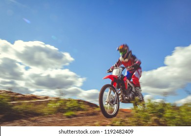 woman on enduro motocross in motion, desire for victory, dynamics of speed.