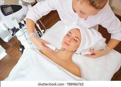 Woman on facial skincare procedure.