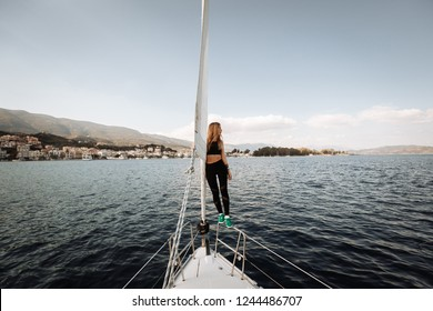 Woman on feed of yacht. Sailing sport